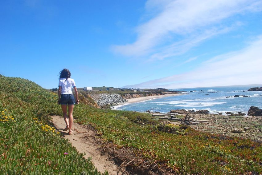 🌊 EyeEm Best Shots EyeEmNewHere Blue Lifestyles Beach Day Walking Water Rear View Nature Sky Real People Full Length Sea