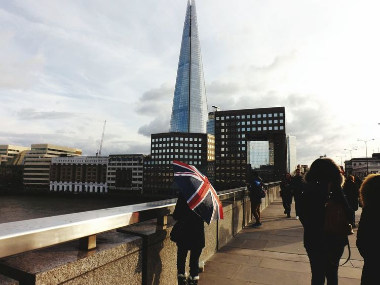 Street Union Jack on London Bridge Architecture Capital Cities  Capital City International Landmark Famous Place Tall - High Shard London Bridge Structure City Outdoors London Lifestyle Uk Perspective Skyscraper London - England Person Umbrella People Union Jack Built Structure The Street Photographer - 2016 EyeEm Awards Sunshine Bridge - Man Made Structure Walking EyeEm LOST IN London Shades Of Winter