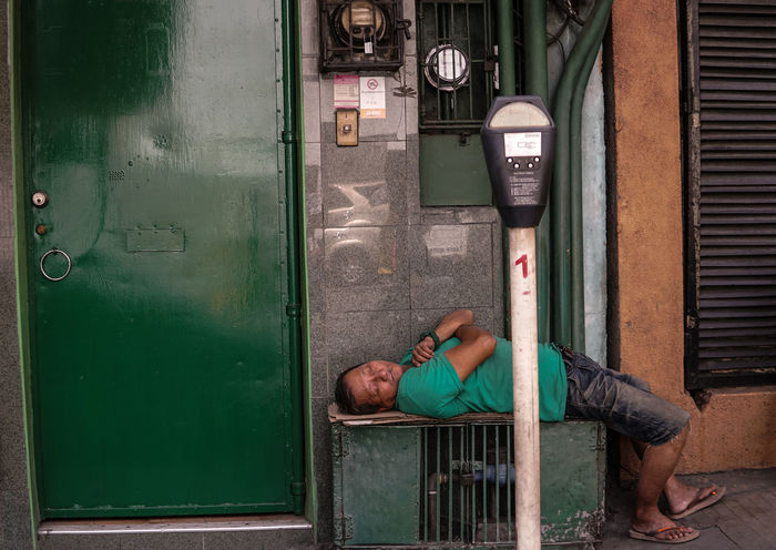Sleeping man in green, Manila. Adult Adults Only Day EyeEm Best Shots Eyemphotography Full Length Green Color Green Day Green Gate One Person Real People Sleeping Sleepingman Street Shot Streetphotography
