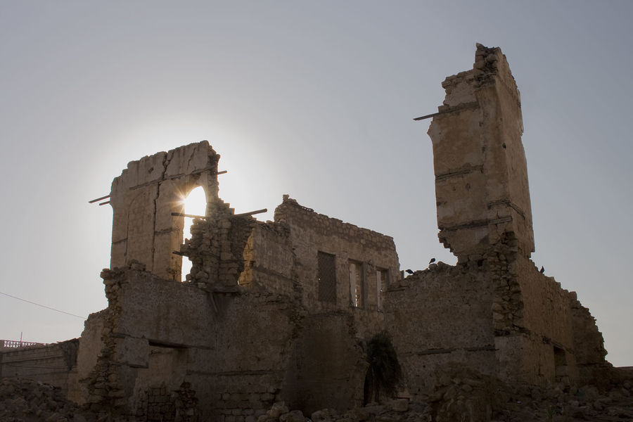 Destroyed Building in Massawa - Eritrea Backlight City Clear Sky Eritrea INTERTOURIST Massawa Old Town Africa Ancient Architecture Day Destroyed Buildings Dramatic History Low Angle View No People Outdoors Red Sea Sky Sun War