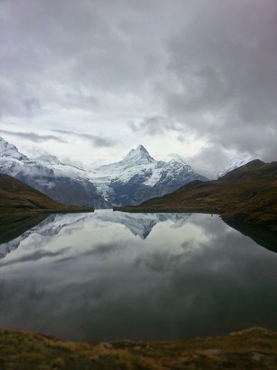 Mönch Jungfrau Eiger Eiger Moench Jungfrau Grindelwald Swiss Mountain Grey Sky Reflection Lake Snow Hike Dam