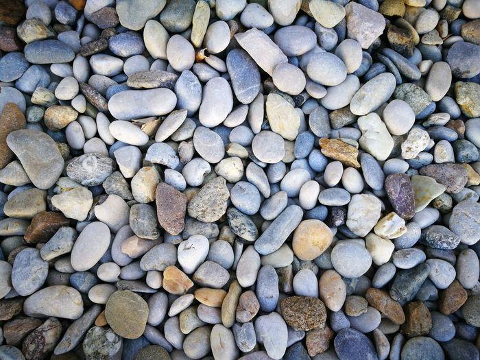 Full frame shot of pebbles at beach