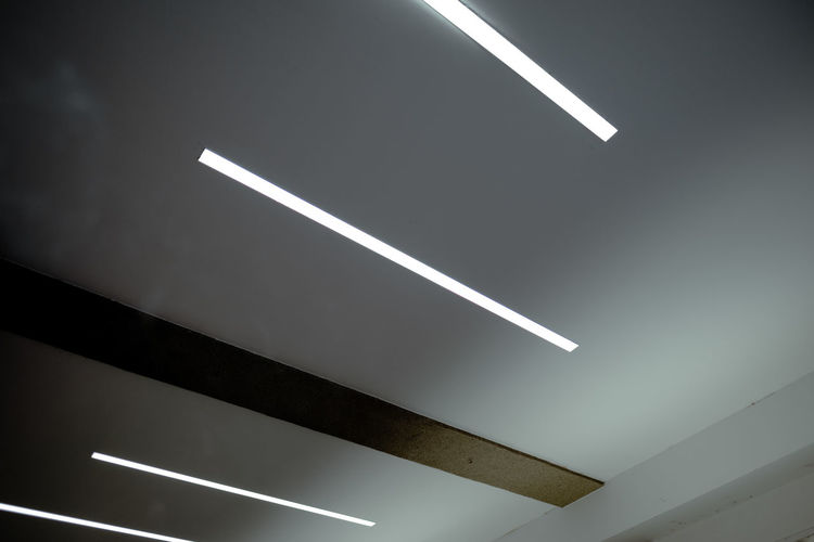 SOME LEADING LINES No People Architecture Built Structure Illuminated Ceiling Indoors  Low Angle View Lighting Equipment White Color Fluorescent Light Sign Transportation Night Symbol Direction Nature Light - Natural Phenomenon Glowing