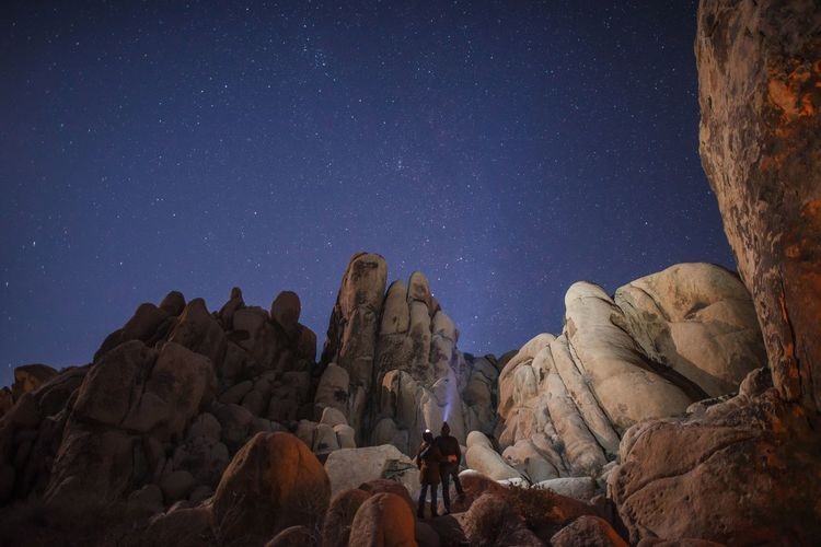 Low angle view of rock formation against clear sky at night