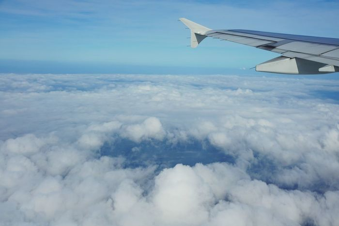 27/12/2014 to Da Nang City. Starting A Trip From An Airplane Window Traveling Clouds And Sky