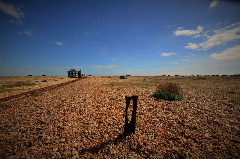 No People Sky Blue Sky And Clouds Fishermanslife Pebble Beach Beachlife Coastal Desolate Forgotten Seaside Deserted Dungeness Foreground Shadows Cloud - Sky Wide Shot Tracks Forgotten Places  The Past High Sun Wild West