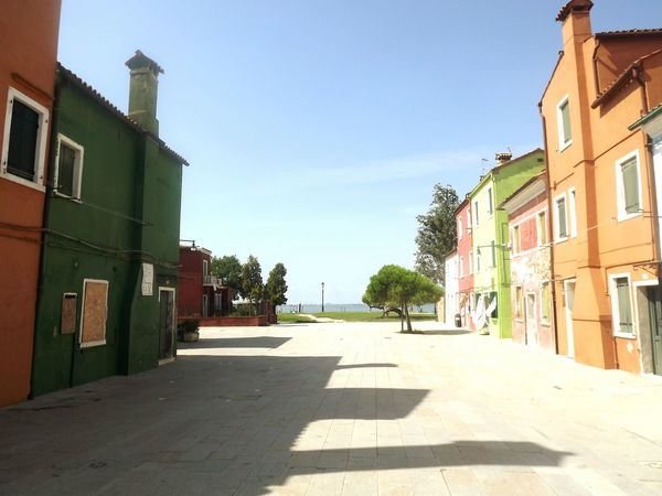 Burano Clear Sky Diminishing Perspective Residential District City Life Coloured Houses Architecture building exterior Sunlight Shadow Outdoors Venezia Venice Italy Italia The City Light Colour Your Horizn Adventures In The City