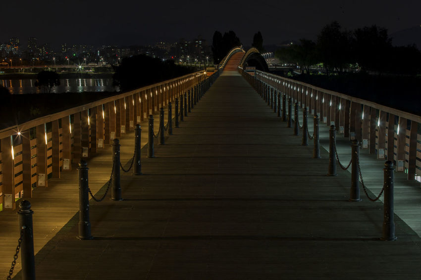 Architectural Column Architecture Boardwalk Bridge City Diminishing Perspective Empty Illuminated In A Row Long Narrow Nature Night No People Outdoors Seonyoudo Seonyugyo Sky The Way Forward Tranquility Tranquility Travel Destinations Vanishing Point Walkway Yanghwa Hangang Park
