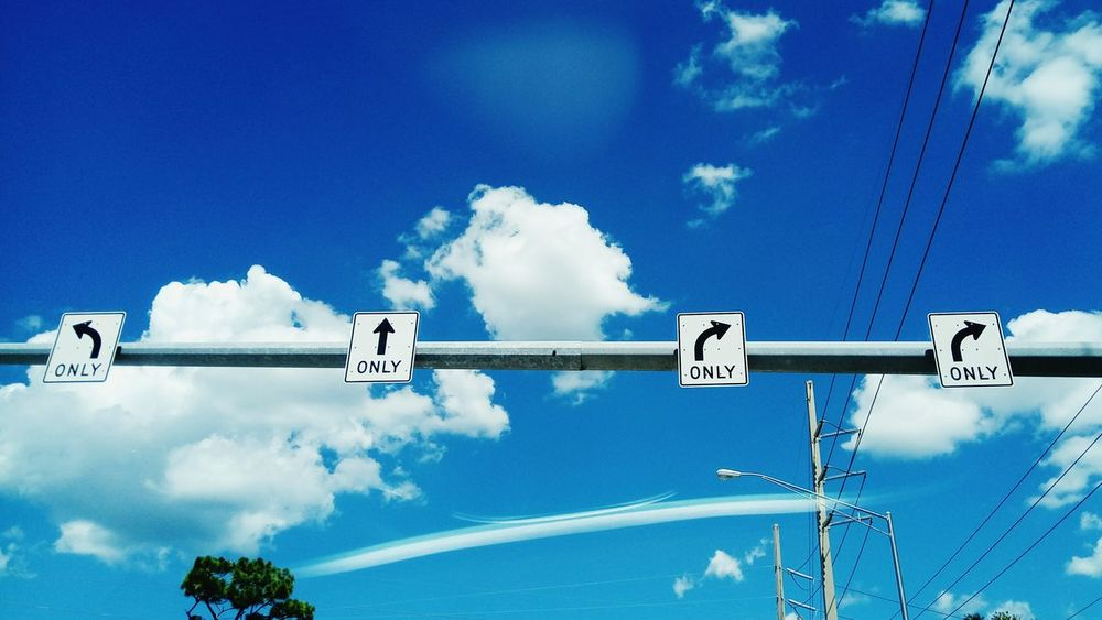 Only way street signs. Cloud - Sky Sky Day Outdoors Letters Metal Sign Daylight Road Marking Road Signal Road Signs Roadways Road Markings Options No People Blue Street Photo