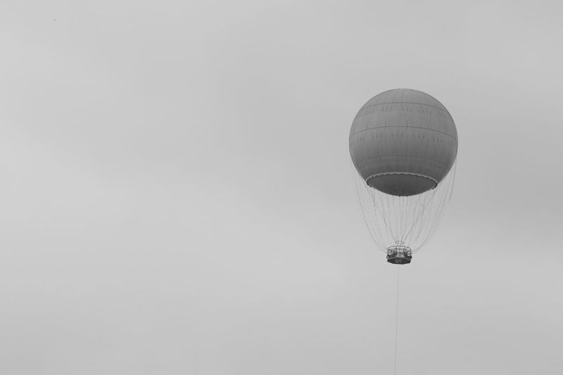 Ballon Cloudy Day Hot Air Balloon No People Outdoors Pollen Sightseeing Sky Advertising Weather Lookout