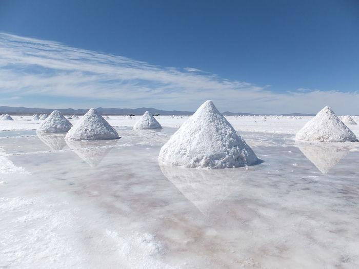 Close-up of salt lake against sky