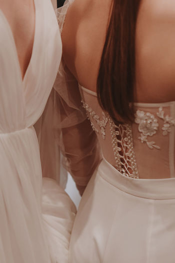 Details of the wedding dress. airy fabric. back view. vertical
