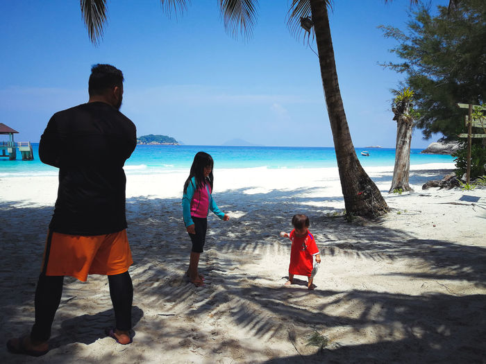 Pulau Redang, Terengganu, Malaysia. Sea Beach Water Land Real People Sky Leisure Activity Child Rear View Nature Lifestyles Family Beauty In Nature Men Women Scenics - Nature Togetherness Casual Clothing Childhood Horizon Over Water Outdoors