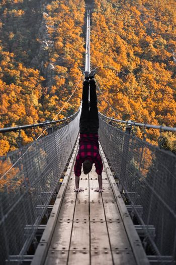 EyeEm Selects Autumn Change Suspension Bridge Bridge - Man Made Structure Connection Footbridge The Way Forward Outdoors Tree Forest Nature Leaf Beauty In Nature Day Scenics Real People The Week On EyeEm EyeEm Best Edits EyeEm Best Shots Second Acts Be. Ready.