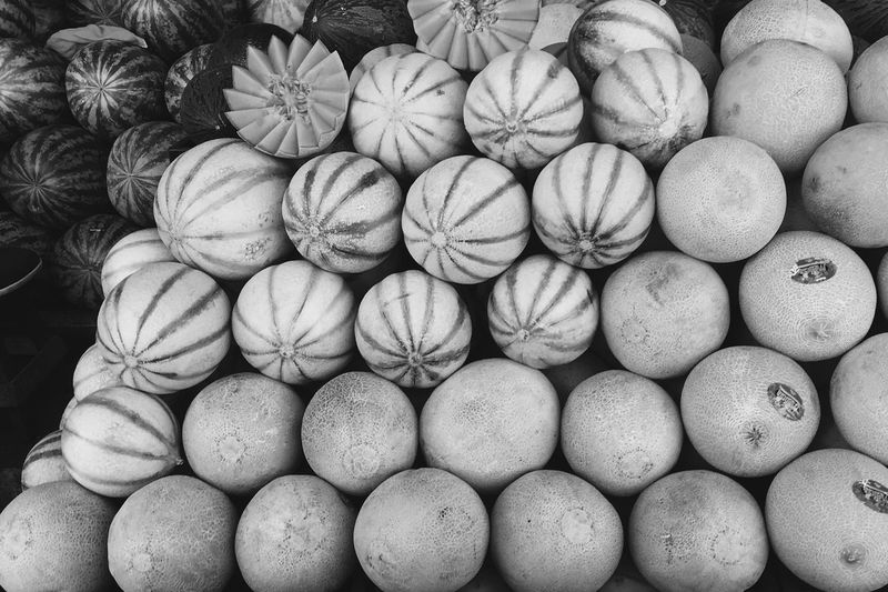 Close-up of cantaloupes for sale at market stall