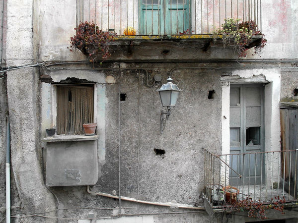 Streetlight between two windows Italia Old Town South Italy Streetlamp Architecture Balcony Building Exterior Built Structure Calabria Flower Glimpse Outdoors Streetlight Travel Destination Two Windows Verbicaro Window Window Box