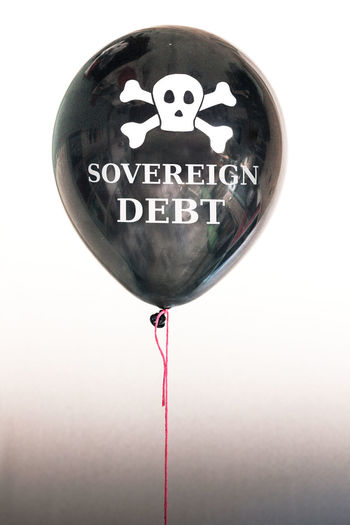 Bond Economics Economy Balloon Bubble Close-up Communication Day Debt Debt Bubble Debt Crisis Government Debt Insolvent No People Pop Repayment Skull Sovereign Debt Studio Shot Text White Background