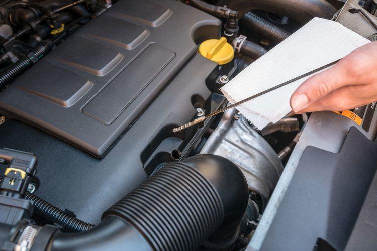 Close-up of man repairing car engine