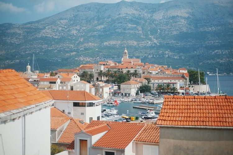 Architecture Building Exterior Built Structure City City Life Cityscape Community Croatia Day Hill House Korčula Mountain Mountain Range No People Outdoors Residential Building Residential District Residential Structure Roof Rooftop Sky Town TOWNSCAPE Travel Destinations
