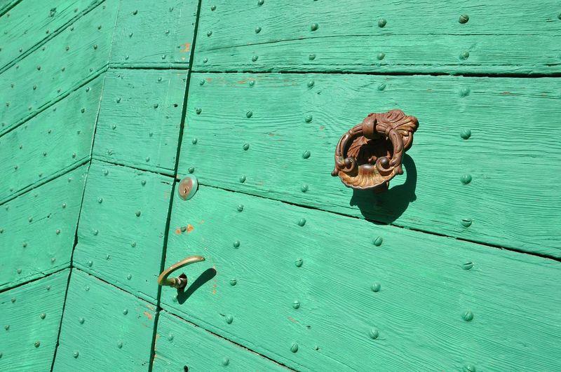 High angle view of metal door on wood