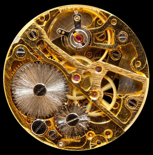 Macro close up of the inside of an old watch showing the cogs and springs Isolated Tiny Black Background Brass Clock Close-up Cog Cogs Cut Out Detail Dramatic Equipment Macro Mechanism Metal Studio Shot Telling The Time Ticking Time Time Passing Watch