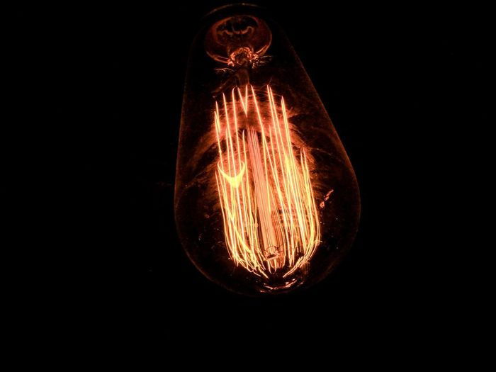 Black Background Illuminated Studio Shot Light Bulb Close-up Indoors  Lighting Equipment Electricity  No People Copy Space Filament Transparent Single Object Glass - Material Dark Cut Out Light Technology Glowing Light - Natural Phenomenon