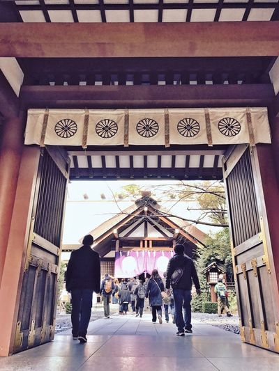 Building Exterior Built Structure Architecture Real People Lifestyles Text Entrance Outdoors Travel Destinations Large Group Of People City Day Entering Place Of Worship Shrines & Temples Shrine Of Japan IPhoneography Shotoniphone7 Streetphotography EyeEmJapan Japan Photography Entrance Tokyo