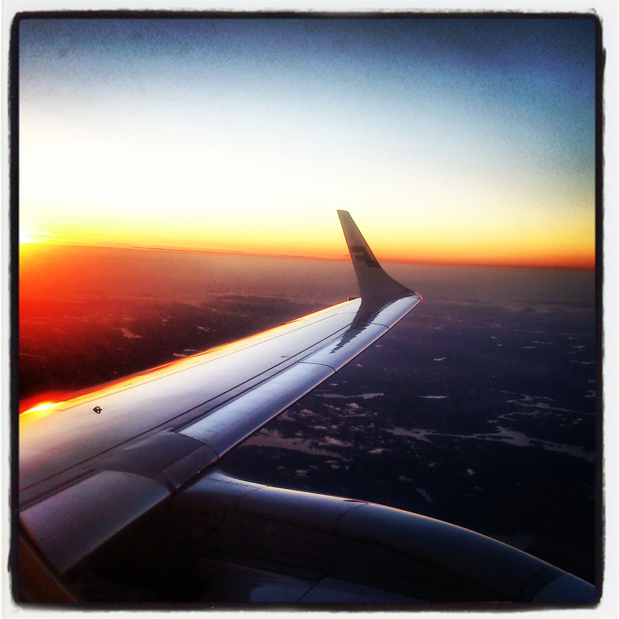 flying, transportation, airplane, sunset, aircraft wing, air vehicle, mode of transport, sky, mid-air, travel, part of, on the move, journey, landscape, scenics, orange color, beauty in nature, nature, cropped, airplane wing