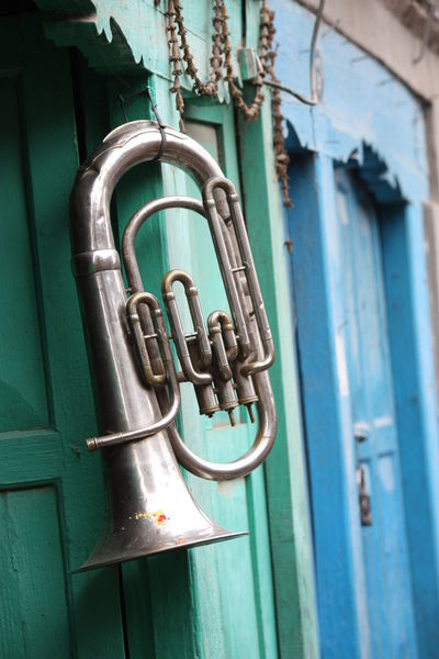 Tuba at a shop in Kathmandu Blue And Green Focus On Foreground Hanging Instrument Music Tuba TakeoverMusic