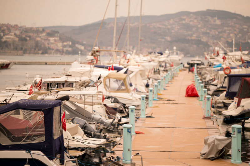 Pier amidst boats moored at port in bosphorus