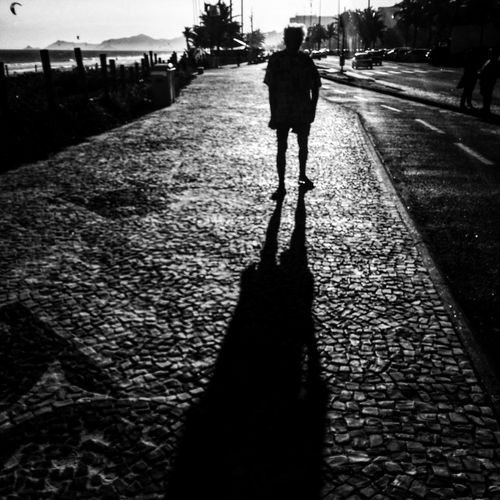 Woman walking on road