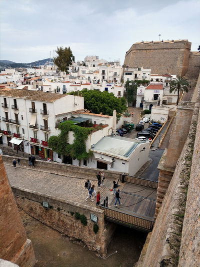 Ibiza Island, Spain - May 5, 2018: Old town of Ibiza. Tourists at the main entrance to the walled enclosure of Ibiza, it was built between 1584 and 1585. Balearic islands, Spain Castle Eivissa Ibiza Ibiza Island Ibiza, Spain Old Town SPAIN Architecture Balearic Islands Bridge - Man Made Structure Building Building Exterior Built Structure City Dalt Vila Day Europe Fortification Fortress History Ibiza Old Town Ibiza Town Outdoors Residential District Town