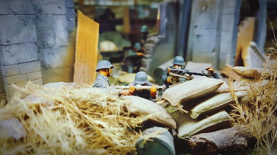Army soldiers figurine and sack with plants