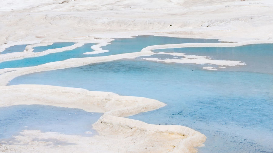 Natural travertine pools and terraces in pamukkale at turkey.