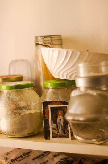 Close-up of jars on shelf