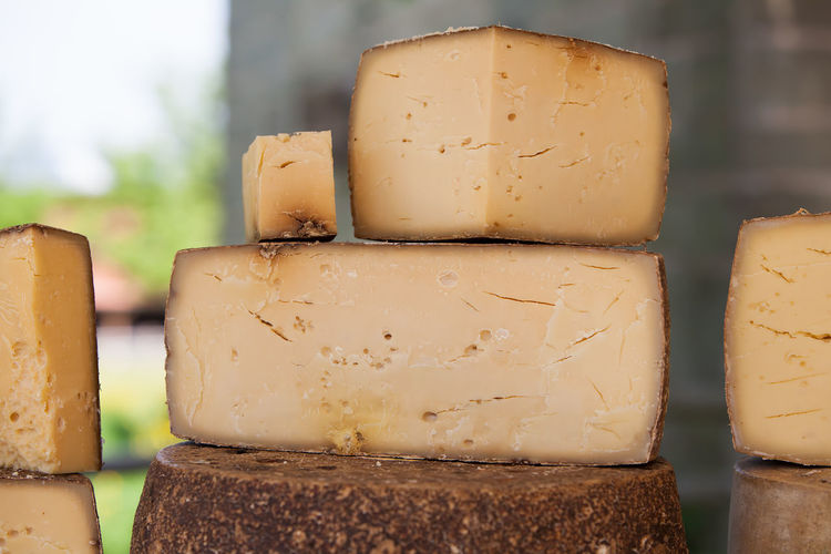 Many loafs of hard cheese Cheese Close-up Dairy Product Dessert Eat Farmers Market Food Food And Drink Freshness Gourmet Hard Cheese Indulgence Loaf Market No People Product Raw Food Ready-to-eat SLICE Snack Swiss Switzerland Table Traditional
