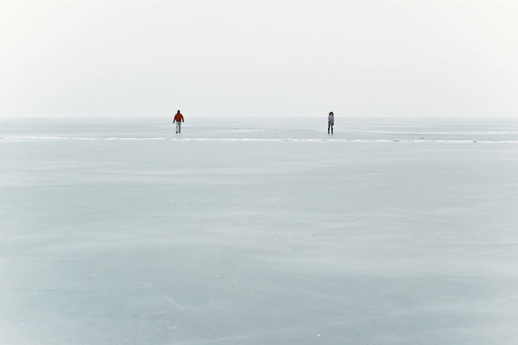 Adventure Beauty In Nature Cold Temperature Frozen Ice Field Lake Balaton Lake Balaton, Hungary Landscape Leisure Activity Loneliness In A Picture Loner Nature Outdoor Activities Outdoor Pursuit Outdoors Paralel Universes People Sky Snow Vast Field Vast Ice Field We Are Alone Together Winter Winter Activities Winter Activities On A Frozen Lake
