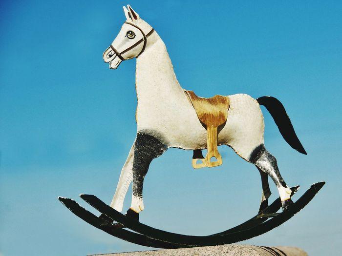 Horse Ironhorse Toy Iron Horse Saddle Rocking Chair Toy Toy Horse No People Hendmade Rocking Out Sky Blue Background