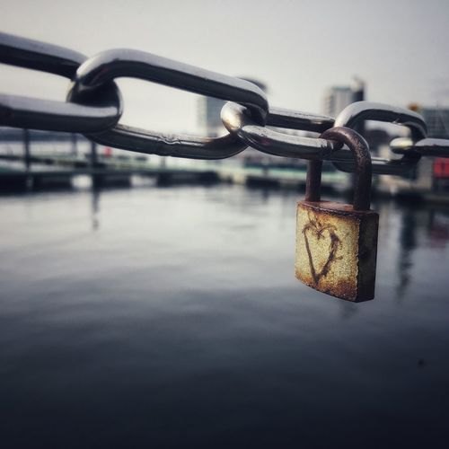 Love is? Dockside Bay Chain negative space Love Focus On Foreground Safety Padlock Protection Lock Metal Close-up Water Outdoors Hanging Day