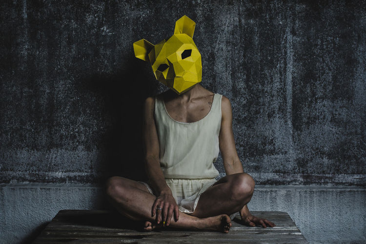 Adult Dark Dark Art Day Headwear Horror Indoors  One Person People Real People Sitting Yellow Young Adult Young Women