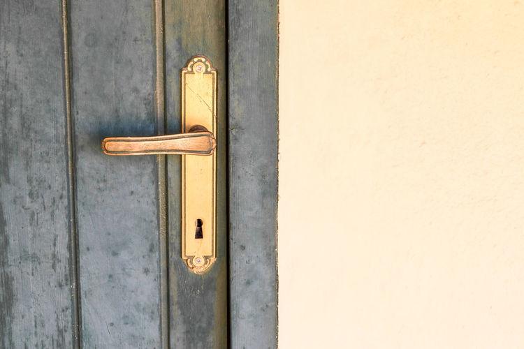 Wood - Material Entrance Exit No People Wall Door Handle Closed Door Entry Doorway Keyhole Doorknob Entryway Front Door Door Knocker Locked Ajar Hinge