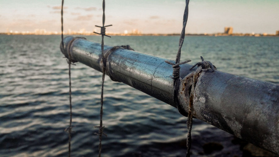 Cityscape Close-up Cloud Day Deterioration Focus On Foreground Horizon Over Water Metal Metallic Nature No People Ocean Old Outdoors Part Of Run-down Rusty S Safety Seascape Selective Focus Sky Sunset Tranquility Water