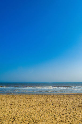 Sea Beach Water Sky Blue Land Horizon Over Water Horizon Scenics - Nature Tranquility Beauty In Nature Sand Tranquil Scene Copy Space Nature Idyllic Clear Sky Day No People Outdoors Portrait Beach Photography Space For Text Space For Copy