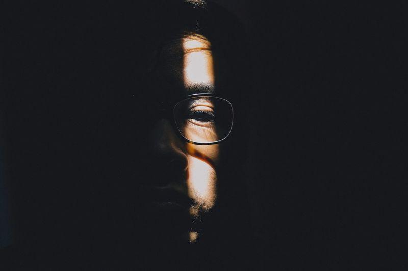 Portrait Of Man In Shadow