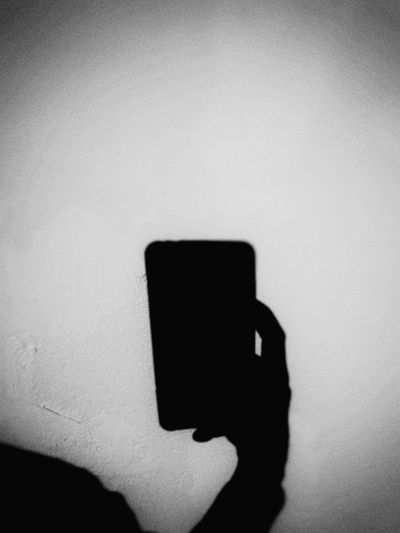 b&w Black&white Photography Hand Creative Light and Shadow Shadow In The Wall Wireless Technology Fingerprint Photographing Portable Information Device Focus On Shadow Cellphone Screen