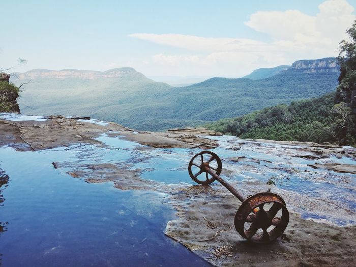 Rusty Wheels By Mountain Range At Blue Mountains National Park