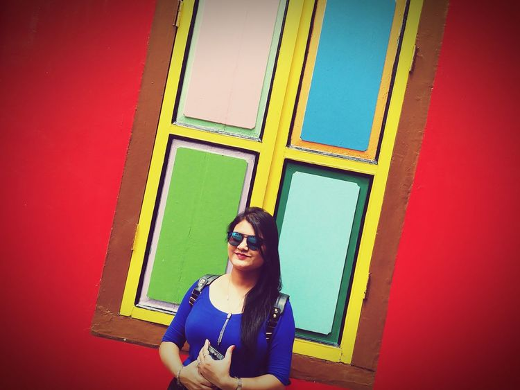 Truly vibrant, Truly colourful, Truly Indian Lifeissimple Life Is Colourful Indian Model Indian Locality Indian Vibrance Colourful Window Bright Colours Vibrance EyeEm Selects Multi Colored One Person One Woman Only Sunglasses Retro Styled Smiling Portrait EyeEm Ready