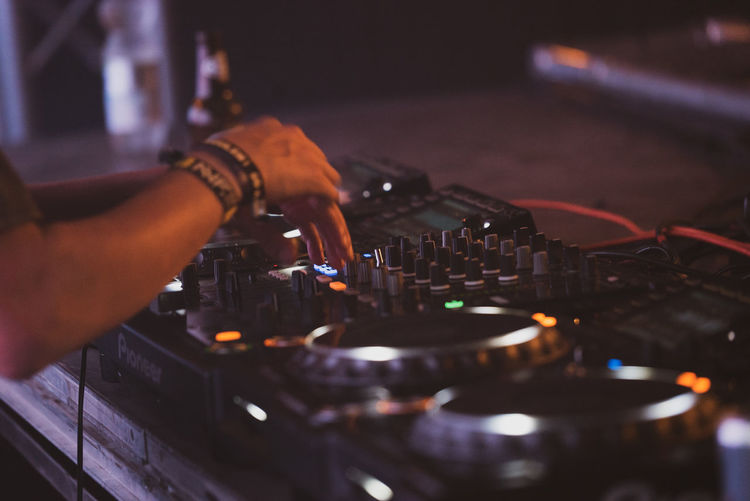 Arts Culture And Entertainment Audio Equipment Close-up Club Dj Equipment Expertise Finger Hand Holding Human Body Part Human Hand Indoors  Music Nightlife Occupation One Person Real People Selective Focus Skill  Technology Working