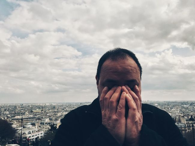 Depression - Sadness One Person Sky Headshot Cloud - Sky Real People Built Structure Portrait Men Day Cityscape Lifestyles