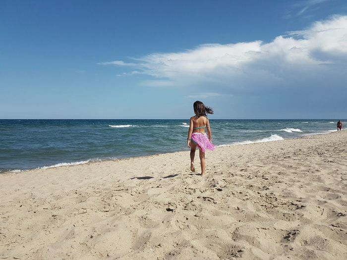 Enjoying The Sun Child At The Beach Sicily Landscape Blue Beach Sand Summer Sky Tranquil Scene Tranquility Ocean Child At Sea Mobile Photography